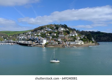 Dartmouth with a single sailing boat