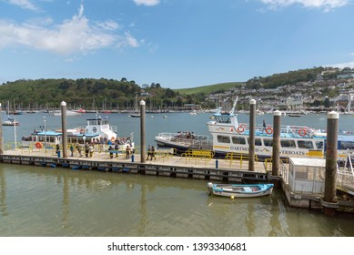 Dartmouth, South Devon, England, UK. May 2019. The Dartmouth town jetty and Kingswear Princess ferry crossing River Dart to Dartmouth.