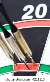 Darts. 180 points hit. Three by triple 20