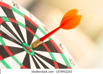 Darts arrow hitting in the target center of dartboard. concept business goal to marketing success. Business target or goal success and winner concept. success and risk management.