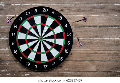 darts arrows missed their target (target) on wood wall background