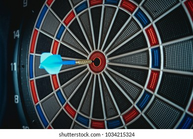 Darts arrows in the target centre with dark background, Business marketing concept