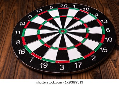 Darts board. Target on wooden table background.