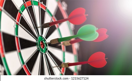 Darts in bulls-eye close up, purpose concept