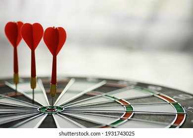 Darts. The dart for playing in the game board is stuck. Hit the sector in darts. The concept of successful strategy.