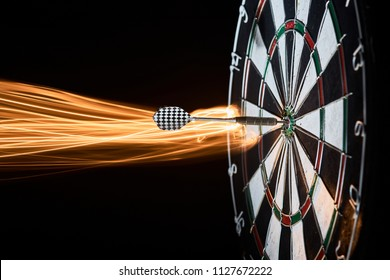 darts. Dartboard. dart in bullseye. light trace
