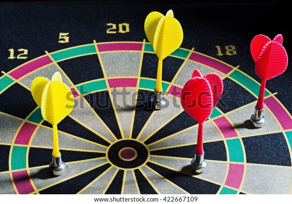 Darts hit the target, dart closeup as a background, miss the shot