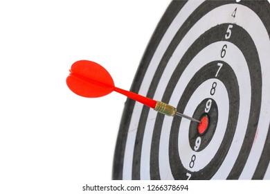 Darts hitting on dartboard isolated on white background.