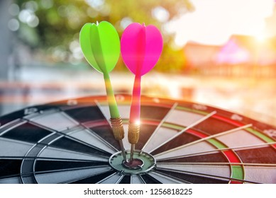 Darts hitting target on Dartboard with bokeh, concept Business investment that rely on precision away be alert to success so game,