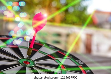 Darts hitting target on Dartboard with bokeh and Knoll light factory, concept Business investment that rely on precision away be alert to success so game,