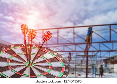 Darts hitting target on Dartboard, construction concept Business investment that rely on precision away be alert to success so game on structure site background,