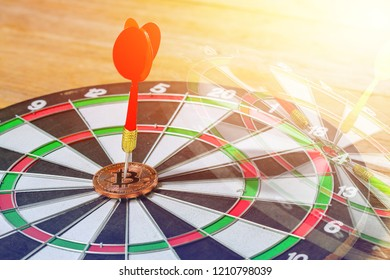 Darts on the bitcon following on dartboard center correct target on the game focuses on success, planning to be smart concept