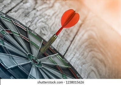 Darts on black Dartboard at wall of wooden with frame, Business investment that rely on precision away be alert to success so game.