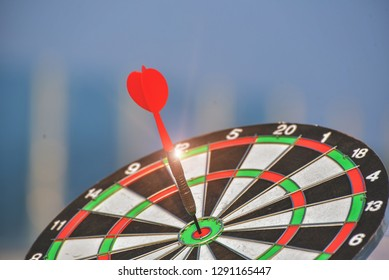 Darts on Dartboard blue sky, Business investment that rely on precision away be alert to success so game,