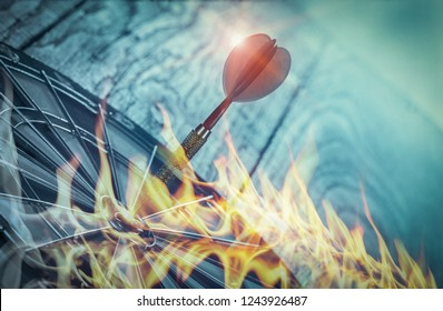Darts on Dartboard at wall of wooden with flame, Business investment that rely on precision away be alert to success so game on blue tone