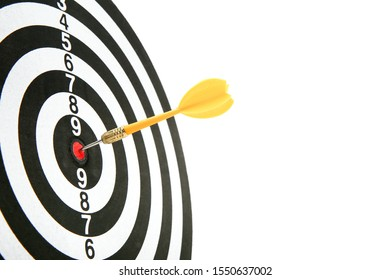darts on white background with copy space. yellow dart in the center of the target