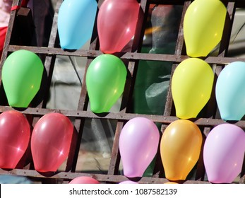 darts shooting gallery with colorful balloons, outdoor