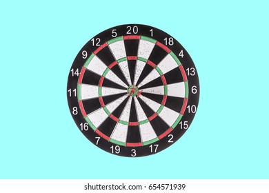Darts targeting the center of a dartboard on a light blue background