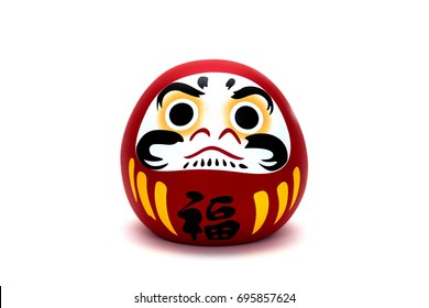 Daruma doll is a talisman for Japanese who will bring success and luck isolated on white background with clipping path