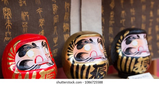 Daruma dolls in Japan - Traditional japanese dolls - Background with kanji / ideograms