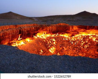 Darvaza gas crater, Turkmenistan. Also known as the door to hell, ie was created by workers who set it on fire in 1971 hoping it would burn out the methane gas but has been burning ever since.