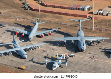 Darwin, Australia - August 4, 2018: Aerial view of military aircraft lining the tarmac at Darwin Royal Australian Airforce Base during a public open day for Operation Pitch Black exercises