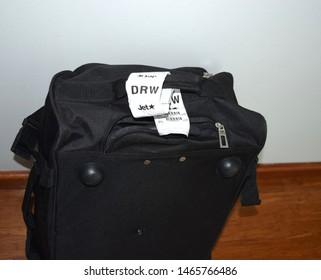 Darwin Australia December 29, 2018: Jet star Darwin flight luggage tag on the black suitcase.