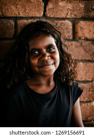 Darwin, Australia-October 05,2018: Australian aborigine girl enjoys a family meal at a local restaurant , Darwin-Australia