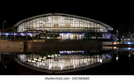 The Darwin Convention Center is reflected in the waters in front of it, illuminated by the evening lights, Australia