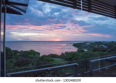 Darwin, Northern Territory, Australia-November 17,2017: Balcony view over pink and blue sunset sky over the Timor Sea Harbour in Darwin, Australia