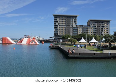 DARWIN, NT - JULY 13 2019: 2019:Visitors at The Darwin Waterfront Precinct, a tourist area in the Northern Territory of Australia in Darwin City.