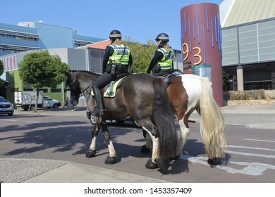 Darwin, NT -JUNE 21 2019:Northern Territory Police Mounted police officers patrolling in Darwin.Some units are trained in search and rescue due to the horse's ability to travel where vehicles cannot