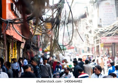 Daryaganj, Delhi, India - circa 2019: Tangled messy electrical wires on pole posing a safety hazard. Households steal electricity by putting illegal connections on power lines bypassing the meter to