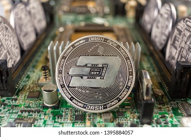 Dash coin close-up on a computer circuit motherboard as a blockchain technology payment network. Digital cryptocurrency concept and mining.