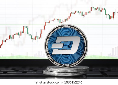 DASH (DigitalCash) cryptocurrency; physical concept dash coin on the background of the chart