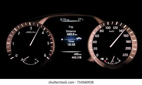 Dashboard car display digital indicator, black background.