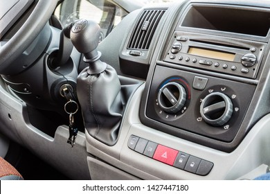 the dashboard of a cheap car with cd player and air conditioning