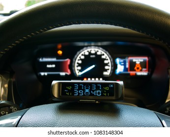 Dashboard close up with tire pressure monitor