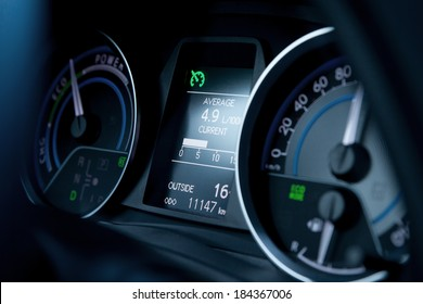 Dashboard and display of a modern car, average fuel consumption, speedometer
