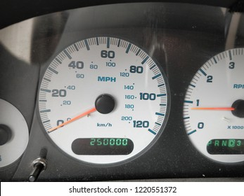 The dashboard of a high mileage vehicle.