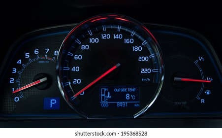 Dashboard of a modern car showing speed, RPM, fuel level, distance, temperature