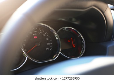 Dashboard of new car with low mileage. Focus on Speedometer.