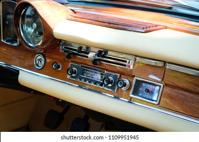 Dashboard, radio and interior of beautiful vintage car cockpit at Classic Days, a Oldtimer  event for vintage cars and  vehicles in Berlin