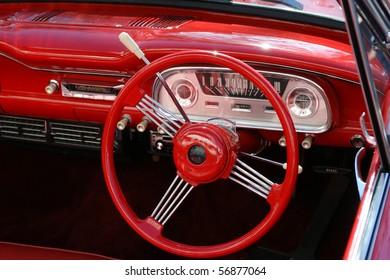 The dashboard of a restored 1960's era car.