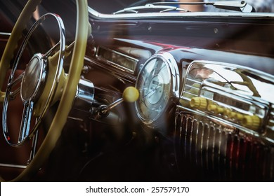 Dashboard and steering wheel in interior of old vintage or retro car or automobile