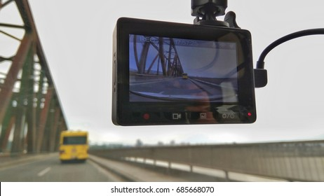 Dashcam in the car recording the bridge and the bus on it