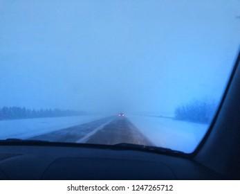Dashcam view of a bleak northern winter highway