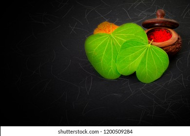 Dashera Festival apta leaf with rice and marigold flower