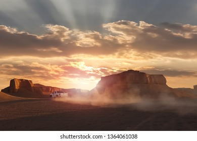 Dasht e Lut desert in Iran. The car in motion on the background of the sunset. Wild nature of Persia.
