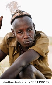 DASSANECH VILLAGE, OMORATE, OMO VALLEY, ETHIOPIA - AUGUST 11, 2018 : A Man from the african tribe Dassanech tribe poses for a portrait